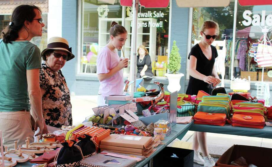 Shoppers browsed goods at the Darien Sidewalk Sale on Friday, July 15. Photo: Erin Kayata / Hearst Connecticut Media / Darien News