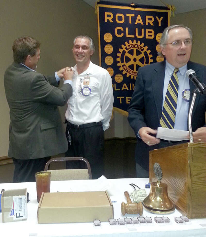 "Courtesy PhotoSteve Long (right) presided over the installation of the Plainview Rotary Club's new president for 2014-15, Ted Baker, as outgoing president David Kopp pins the club president pin on Baker's collar. The Plainview Rotary Club was chartered in 1921 and has provided ""Service Above Self"" both locally and internationally since then. The 75 club members are active throughout the community. The Rotarians in Plainview look forward to ""Lighting up Rotary"" again."