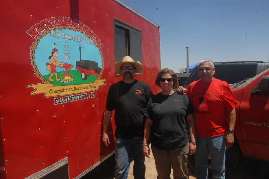 Homer Marquez/Plainview HearaldBBQ pit master Lance Moore and wife Kristi stand next to their food truck at the 2nd Annual Mark Marley Cook-off in Plainview.
