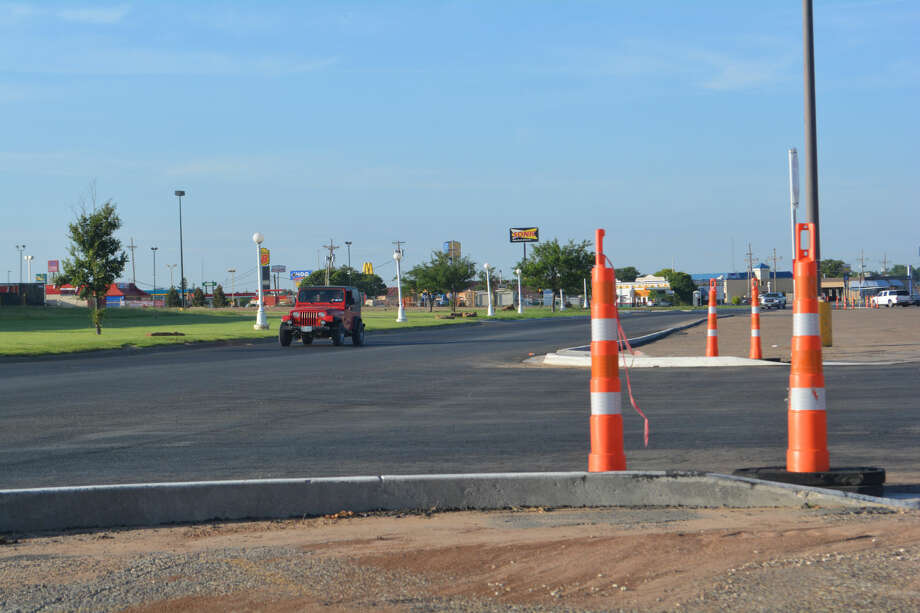 Traffic cones are expected to go back out later this week when crews seal coat the newly constructed stretch of Kermit Drive through the Towne Center parking lot. The $864,000 TxDOT project began in mid-March.