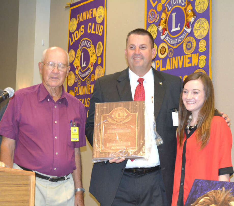 Doug McDonough/Plainview HeraldNew Plainview Lions Club President James Belk (left) presents outgoing Lions Boss Kevin Carter with his past president's plaque. Lions Club Queen Meredith McDonough is shown at right. The induction of new members and swearing in of new officers were held during the club's regular meeting last Wednesday.