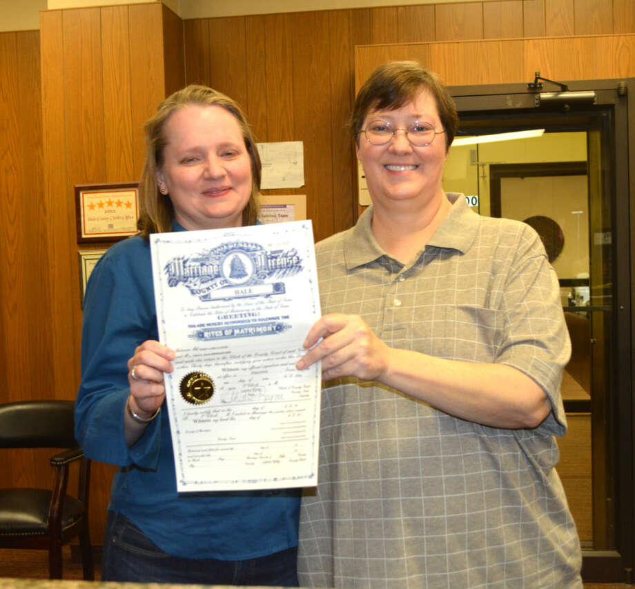 First Marriage LicenseDoug McDonough/Plainview HeraldTracy Weingartner (left) and Lynn Cloude of Littlefield show off their marriage license moments after receiving it Monday afternoon at the Hale County Clerk's office. Cloude grew up in Plainview and graduated from PHS in 1984, but admits that they came to Plainview since neither Lamb County nor Lubbock County are yet issuing licenses to same-sex couples.