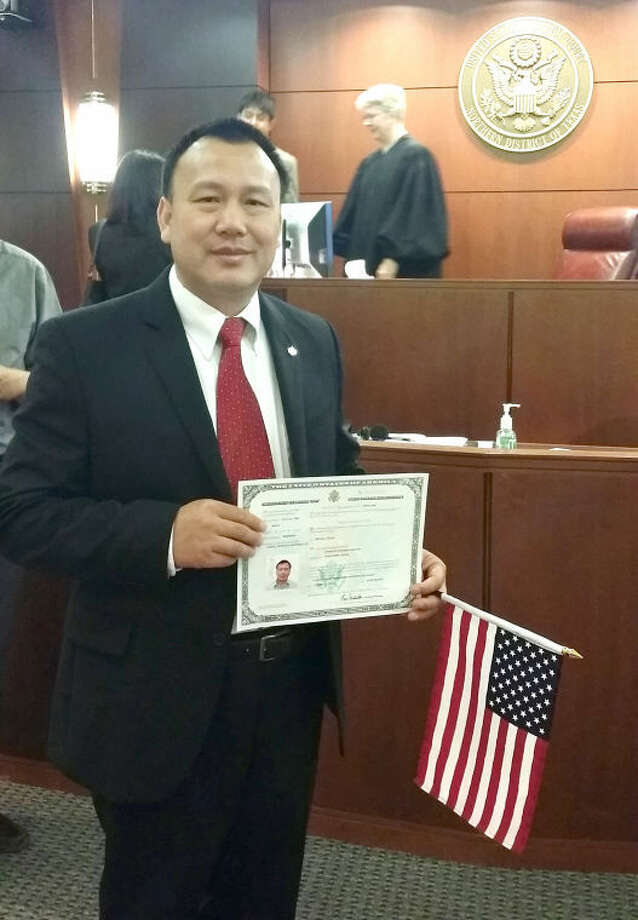 Courtesy PhotoDr. Charles Huang displays his certificate of citizenship after taking the citizenship oath on June 26 in Lubbock. Huang is an assistant professor of exercise and sport science at Wayland Baptist University.