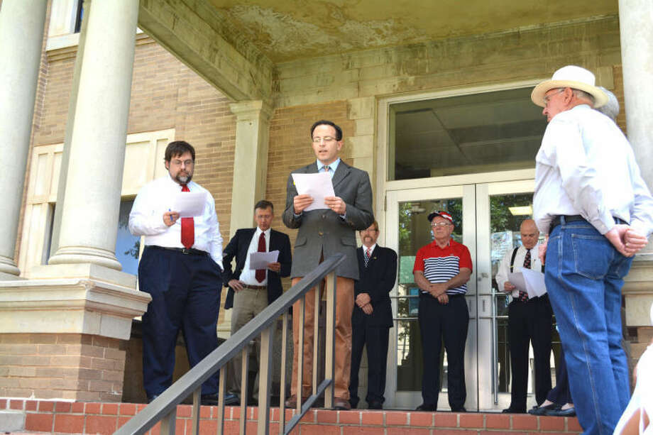 County Attorney Jim Tirey takes his turn reading a portion of the U.S. Declaration of Independence on the steps of the Hale County Courthouse late Thursday morning, recreating a scene from 1776 when the document was first publicly read following its adoption on July 4, 1776, at Independence Hall in Philadelphia, Pa. Thursday's reading was organized by the Hale County Bar Association as part of a statewide effort by lawyers and others associated with the Texas Criminal Defense Lawyers Association. Joining Tirey in reading the Declaration of Independence were County Judge Bill Coleman, Dr. Charles Starnes, Paul Holloway, Kerry Piper, Chris Brown, Kregg Hukill and Troy Bollinger, who coordinated the event. Go to www.MyPlainview.com to view a gallery from the recitation.