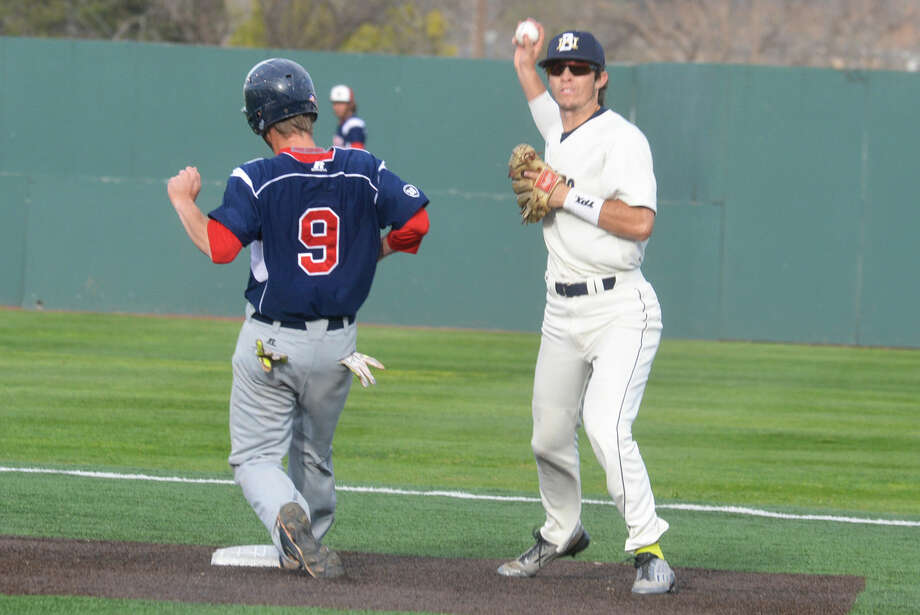 Wayland Baptist University shortstop Aaron Vallance, right, turns a double play during the Pioneers' season. The Amarillo native is one of three WBU players who are currently playing in summer baseball leagues. Photo: Skip Leon/Plainview Herald