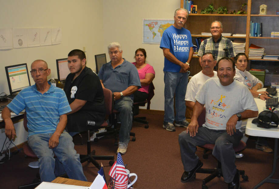 Doug McDonough/Plainview Herald Pausing for a few minutes on Wednesday during their self-paced GED classes at the Plainview Adult Learning Center are Sam Barron (left), Josiah Escanlante, Armondo Pulido, Margarita Pulido, Keith Baker, Reyes Garza, Rogelio Flores, Micaela Valle and Jose Espinosa.