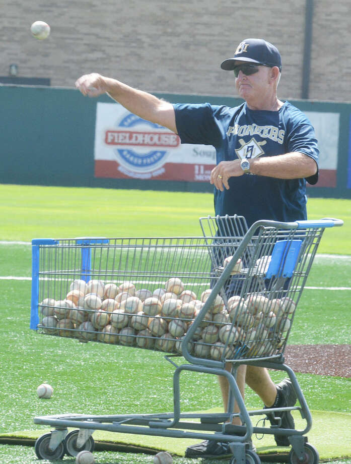 Wayland Baptist University assistant baseball coach Tommy McMillan throws batting practice to youngsters during a WBU summer baseball camp. Photo: Skip Leon/Plainview Herald
