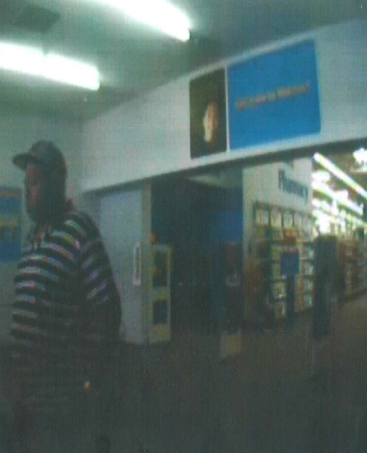 """Plainview police are in search of this man, described as an African-American male in his mid- to late 20s. He weighs around 270 pounds and stands around 5-feet 10-inches. Police suspect the man is the perpetrator of a """"quick change"""" scam in Plainview Photo: Courtesy Photo"""