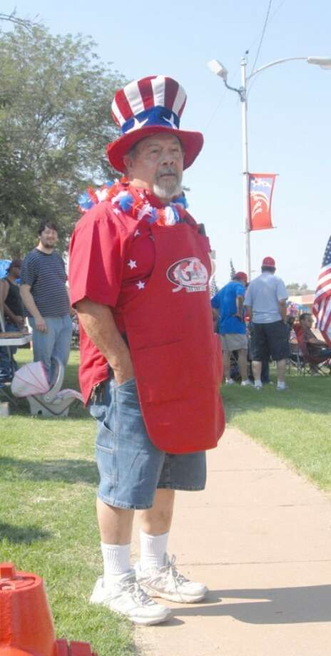 Both Plainview and Hale Center got off to an early start Saturday in celebrating Independence Day with parades. Nino Reyes of Plainview dons his red, white and blue.