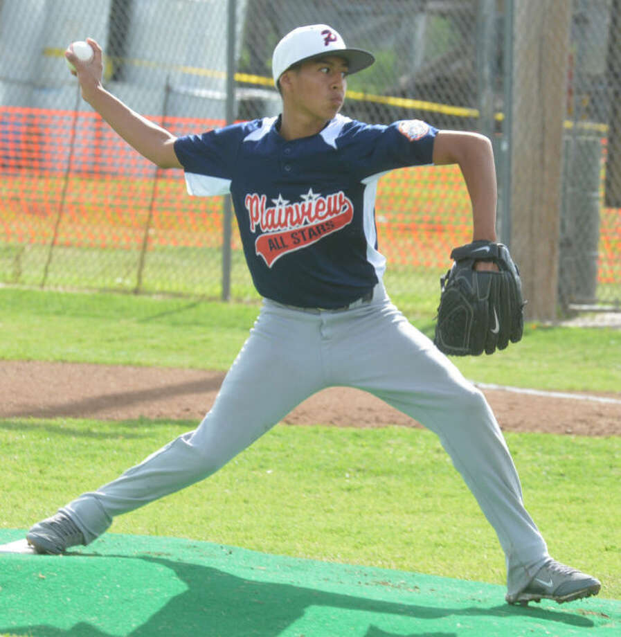 Plainview Blue's Derek Dominguez fires a pitch during the district tournament. The right-hander tossed a three-hit shutout and struck out eight batters in a victory over Seminole at the Cal Ripken 11-12-year-old 70-foot Texas State Tournament in Pampa Tuesday night. Photo: Skip Leon/Plainview Herald