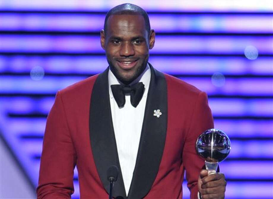 "FILE - In this July 17, 2013 file photo, LeBron James accepts the award for best male athlete at the ESPY Awards at Nokia Theater, in Los Angeles. James is joining forces with Starz and the man behind classic shows like ""The Cosby Show"" to create a sitcom that will touch on something he knows a lot about _ ""Survivor's Remorse."" (Photo by John Shearer/Invision/AP, File) Photo: John Shearer / Invision"