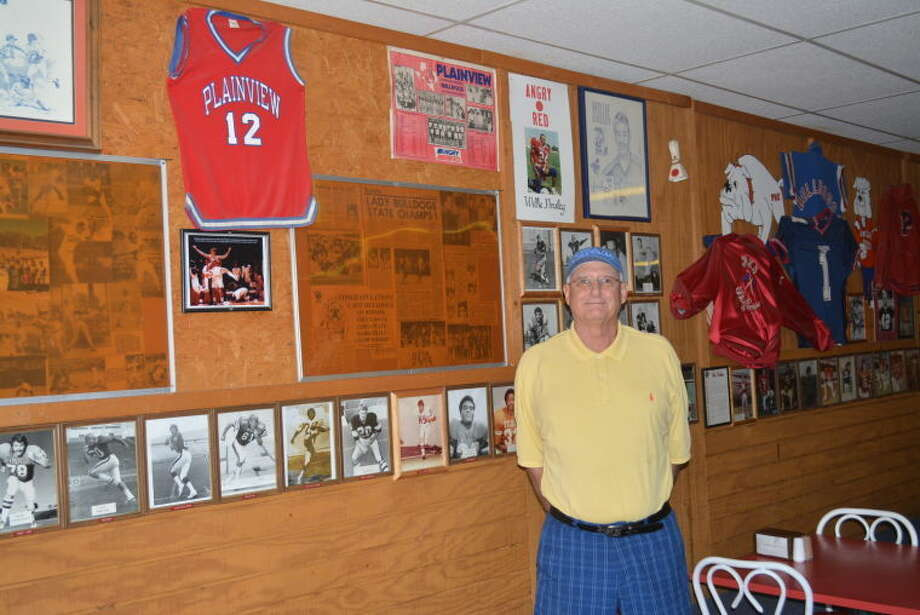"Richard Watson, owner of the Fieldhouse Sandwich Shop, stands next to the ""Wall of Fame"" at his restaurant. Watson plans on selling the shop in October. Photo: Homer Marquez/Plainview Herald"