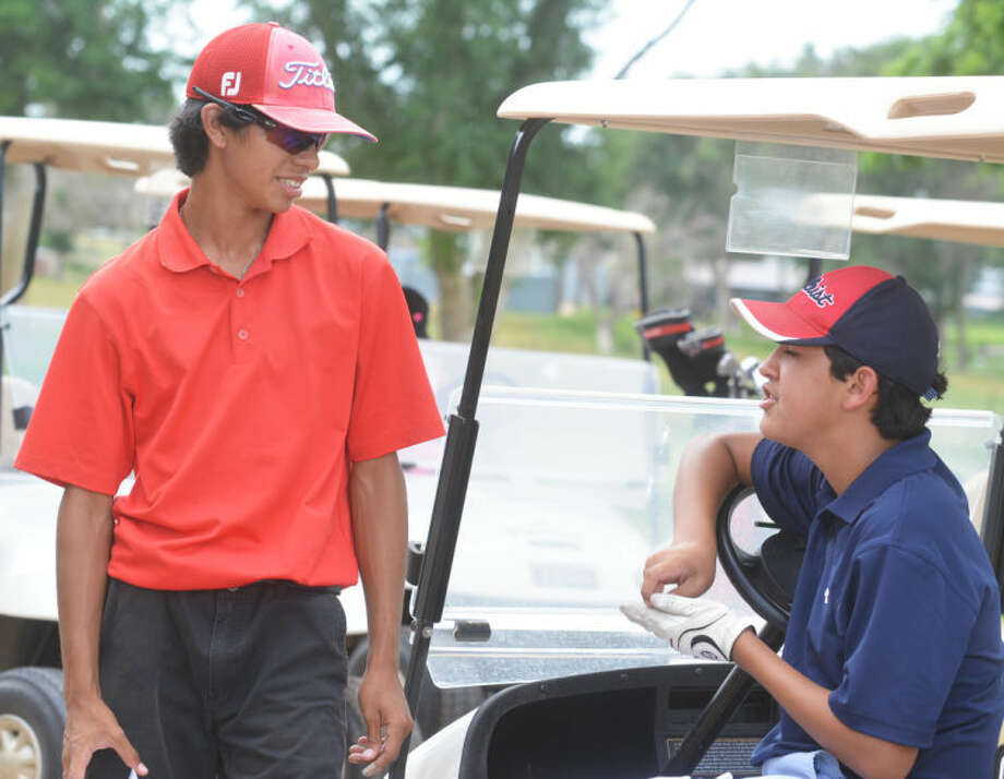 Plainview High School golf teammates Ryan Castillo (left) and Isaiah Garcia talk about their rounds Monday in the Northern Texas Junior PGA Tour event at Plainview Country Club. Castillo won the local event with an even-par 71. Garcia shot even for 15 holes before a bogey and two double-bogeys on the final three holes left him with a 5-over 76. Both golfers played on the Bulldog varsity last season and will be returning sophomores this year. Photo: Skip Leon/Plainview Herald