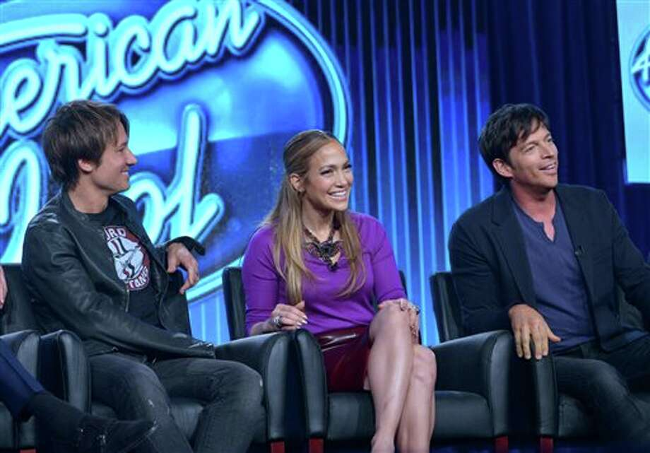 "FILE - In this Jan. 13, 2014 file photo, judges, from left, Keith Urban, Jennifer Lopez, and Harry Connick Jr. are seen during the panel of ""American Idol"" at the FOX Winter 2014 TCA, at the Langham Hotel in Pasadena, Calif. Lopez, Urban, and Connick Jr. will return as judges with Ryan Seacrest hosting for the 14th season of Fox's ""American Idol."" (Photo by Richard Shotwell/Invision/AP, file) Photo: Richard Shotwell / Invision"
