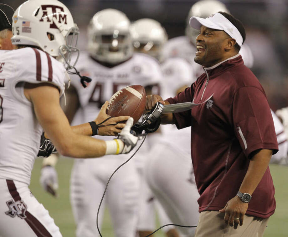 Texas A&M head coach Kevin Sumlin (right), shown reacting to an interception during a Cotton Bowl game, couldn't escape from questions about former Aggie quarterback Johnny Manziel at the SEC Media Day Tuesday. Photo: Rodger Mallison/Fort Worth Star-Telegram/MCT