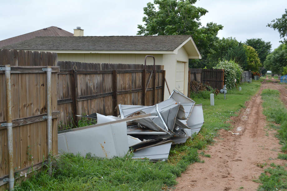 Doug McDonough/Plainview HeraldThe crumpled remains of someone's metal storage building has gone unclaimed for about three weeks in the alley behind the 2700 block of Jefferson Drive in Westgate. The homeowner is seeking help in getting the debris removed from her alley.