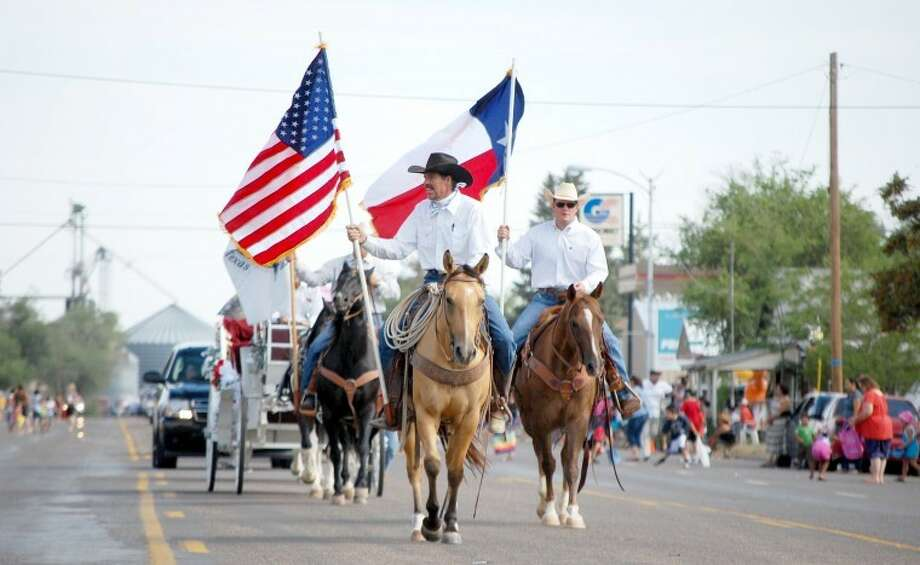 Saturday's parade marking the 32nd annual Sandhills Celebration at Olton began in the traditional way with a mounted color guard.