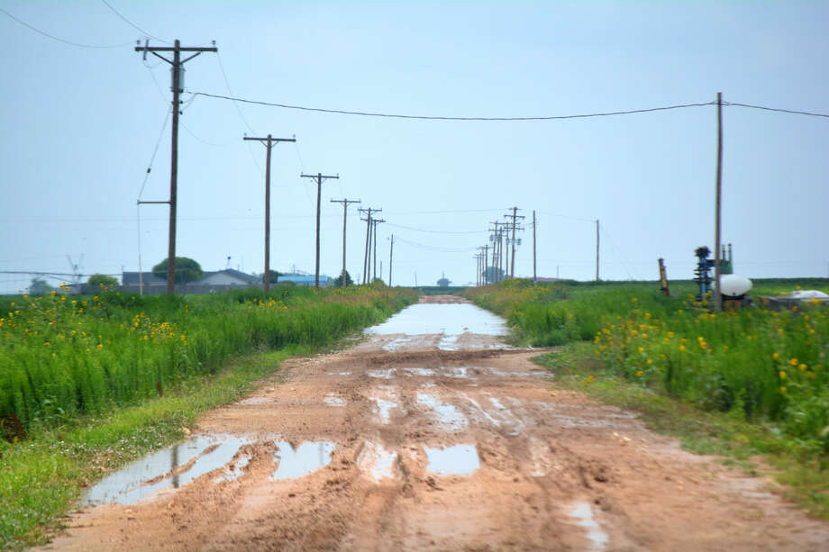 Doug McDonough/Plainview Herald Runoff from heavy rain left County Road 70 east of FM 400 impassible Thursday due to high water. After 4 1/2 years of drought, excessive rainfall this spring and summer have turned many unpaved roadways into muddy, rutted obstacle courses.