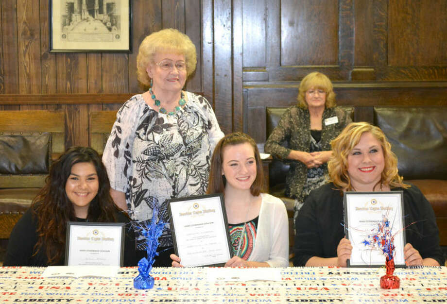 The Ray Blakemore American Legion Post 260 and its American Legion Auxiliary Unit 260 recognized local Girls State and Boys State participants at a banquet Friday at the Plainview Elks Lodge. Theta Vaughan (standing) presented certificates to Jackie Perez (seated left), Meredith McDonough and Kaitlin Lawson who attended Girls State. Also shown is Jerree McKeeman, a member of the Auxiliary.