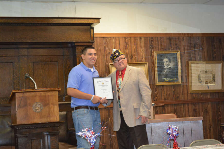 American Legion District Commander Ralph Langley presents a certificate to Richard Salinas in recognition of his participation in Boys State this summer during the annual local Boys State and Girls State Banquet on Friday. Other area participants in Boys State this year include Johnny Barry, Steven Espinosa, Calvin Rodriguez and Anthony Morales. Local Girls State sponsors were the Elks Lodge and Drs. Webb and Webb. Boys State sponsors included Stoerner-Bybee Farms, Kiwanis Club, Halfway Farm Chemical, J.B. & Associates, Turpen Insurance, Quarterway Gin, Inc., Ray Lee Equipment and Kornerstone Funeral Directors.