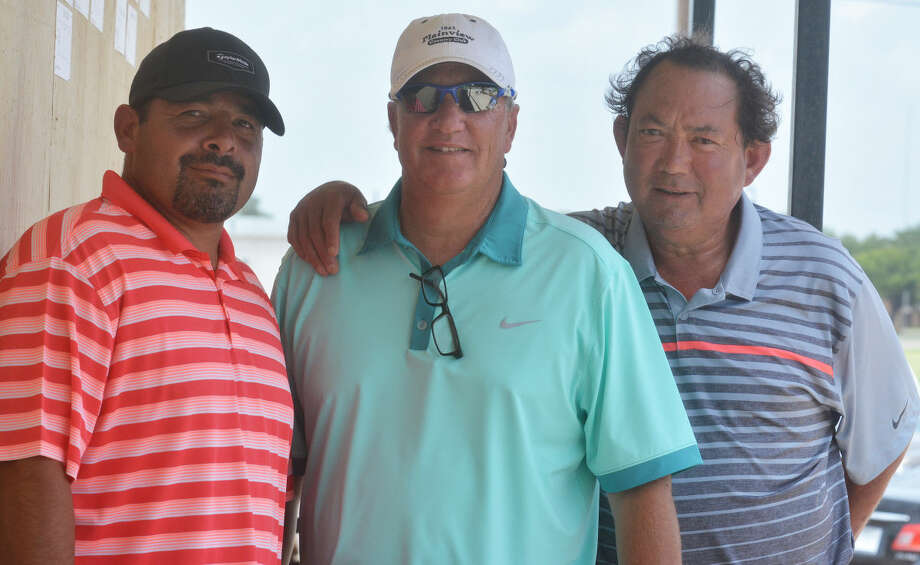 Plainview residents Rudy Vera, right, and Willie Strain, left, spend a moment with Plainview Country Club golf pro Pete Peterson, center, during the Jack Williams Memorial Golf Tournament over the weekend. Vera was one-half of the winning team in the seventh flight. Strain also played in the seventh flight. Photo: Skip Leon/Plainview Herald