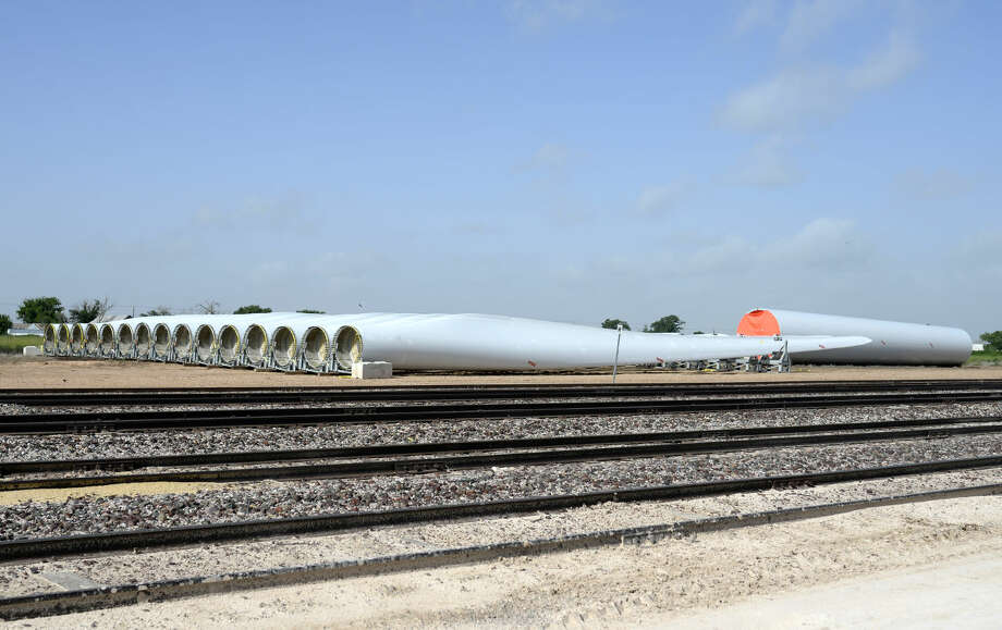 Wind Turbine blades, shipped to Plainview from all over the country, lie near a railway at the Transportation Technology Service distribution hub just east of town. Recently the TTS company was bought by railroad titan BSNF.  Photo: James Durin/MRT