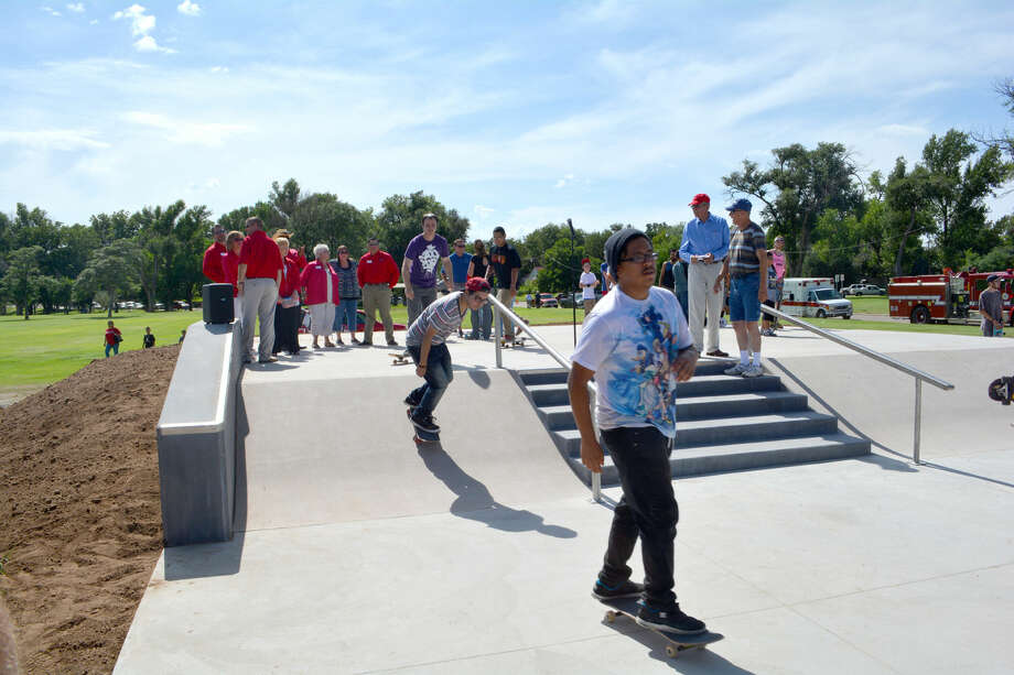 Doug McDonough/Plainview Herald Moments after it was formally opened on Thursday, the first skateboarders begin their runs at the new Plainview SkatePark at Sixth and Joliet in Lloyd Woods Park. Planning on the facility began 15 years ago. See more photos online at www.MyPlainview.com and in Sunday's Herald.