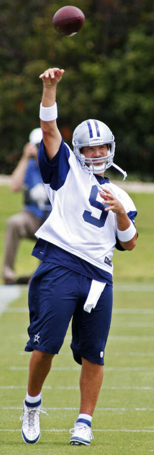 Quarterback Tony Romo, shown throwing a pass during the Dallas Cowboys' Organized Team Activity mini camp last month, is expected to be fully ready when the Cowboys have their first training camp practice Thursday. Photo: Paul Moseley/Fort Worth Star-Telegram/MCT