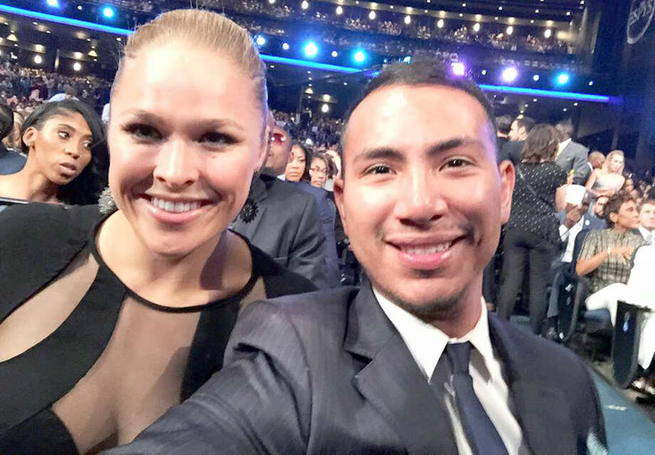 Kress native Alex Ortiz, right, attended the ESPY awards in Los Angeles Wednesday, where he spoke with, among others, popular Mixed Martial Arts (MMA) fighter Ronda Rousey, left. Ortiz works in sports marketing for Oakley, Inc., which is based in California. He said when he sat down at the ESPYs, he couldn't help but think of his humble beginnings in Kress. Later Wednesday night, Rousey won Fighter of the Year and Female Athlete of the Year awards. Photo: Photo Courtesy Of Alex Ortiz