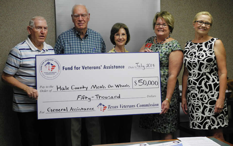 Gail M. Williams/Plainview HeraldHale County Meals on Wheels accepts a $50,000 check from the Texas Fund for Veterans' Assistance (FVA). Shown are Don Smith (left), Meals on Wheels board member; Don Eversole, Meals on Wheels board member; Tara Walker, Meals on Wheels board member; Kathy Wood, director of Texas Veterans Commission; and Kim Horne, director of Hale County Meals on Wheels.