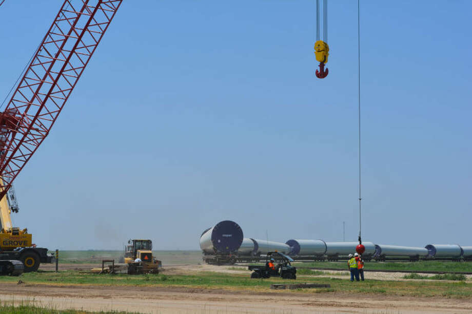 Doug McDonough/Plainview HeraldAs dirt work continues, the first of three local rail off-loading facilities already is receiving wind turbine components. The facility, operated by Energy Transportation, Inc., is adjacent to Azteca Milling. Rail cars carrying portions of what will become wind turbine bases line the circular track. Two similar facilities are planned along U.S. 70 east of Plainview.