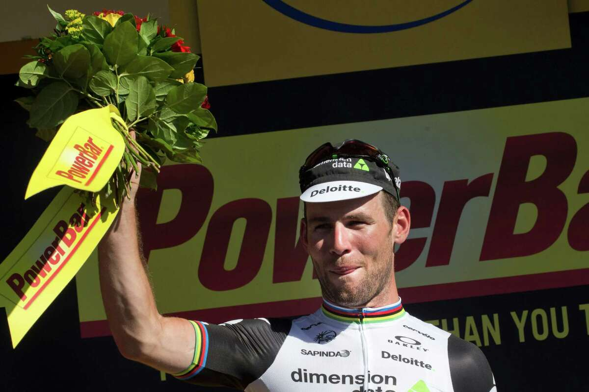 Stage winner Britain's Mark Cavendish celebrates on the podium after the fourteenth stage of the Tour de France cycling race over 208.5 kilometers (129.2 miles) with start in Montelimar and finish in Villars-les-Dombes, France, Saturday, July 16, 2016. (AP Photo/Peter Dejong) ORG XMIT: PDJ102