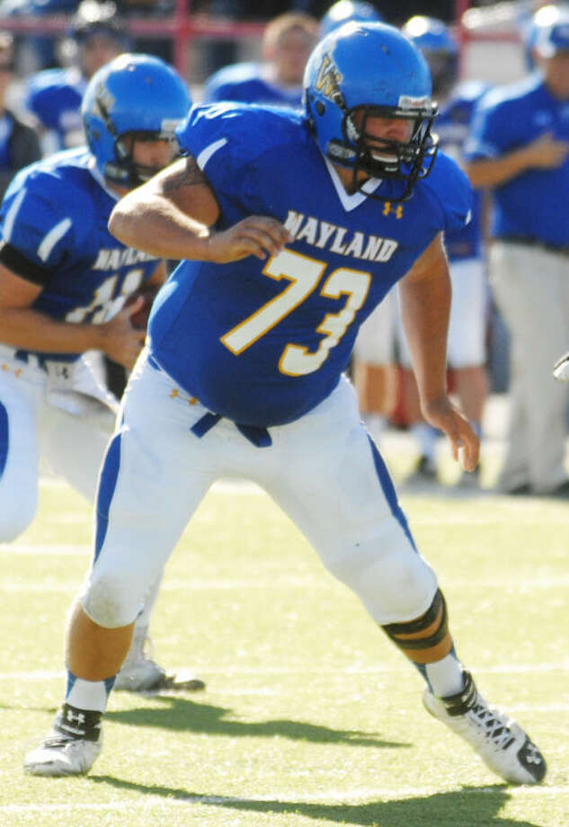 Wayland Baptist University right tackle Jacob King protects the quarterback during a game last season. The former Plainview High School standout started all 10 games as a freshman in 2013 and is one of five returning starters on the offensive line for the Pioneers. Photo: Plainview Herald File Photo