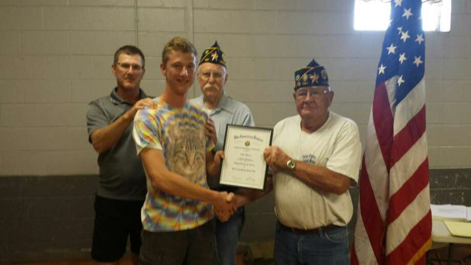 Lockney's American Legion Commander Ed Marks presents a Good Citizenship Citation to Jake Moore, who the post sponsored to attend Texas Boys State this summer. On hand for the presentation are Jake's father and grandfather, Sam Moore Jr. and Sam Moore Sr.