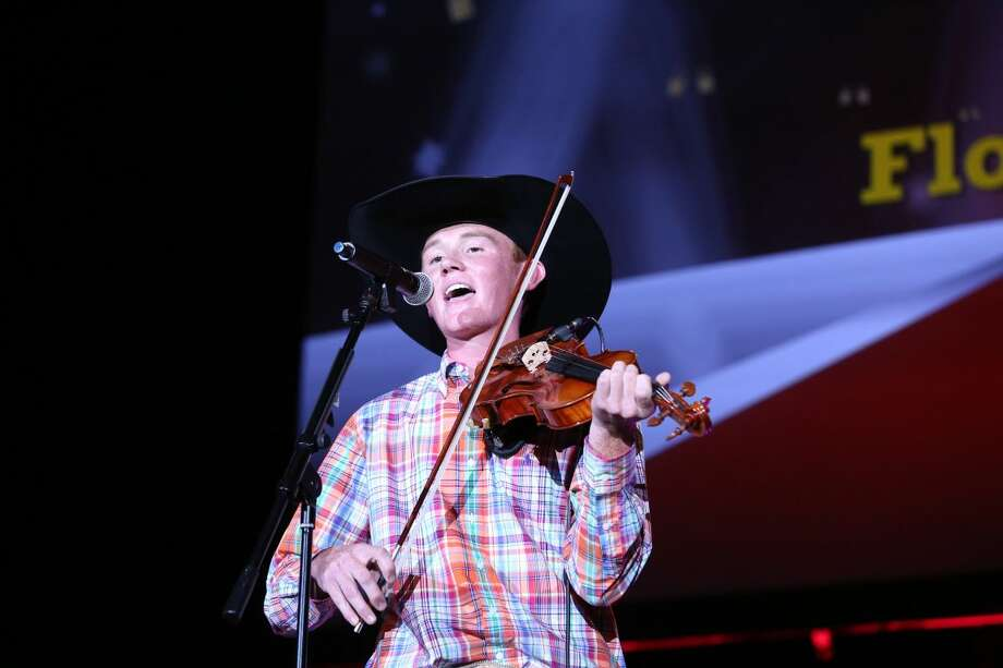 "Kirby Nixon, 17, of Floydada offers his rendition of ""The Devil Went Down to Georgia"" at state FFA convention in Corpus Christi. Photo: Courtesy Photo"