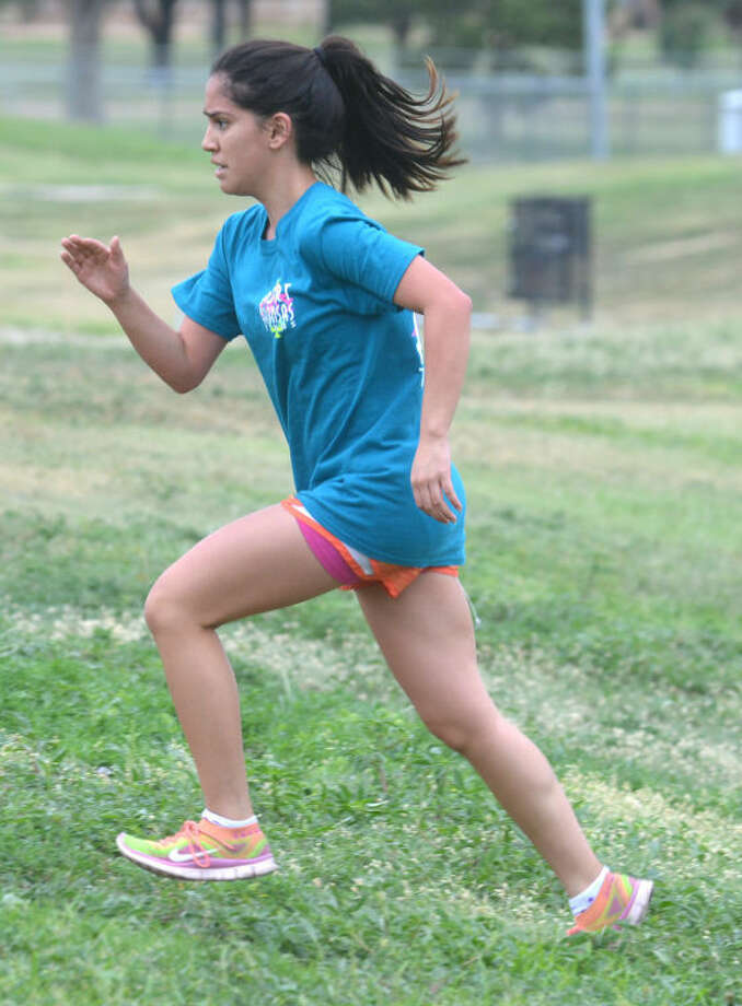 Plainview cross country runner Breana Figueroa races up a hill at Kidsville Park Tuesday morning. Figueroa, a sophomore, is Plainview's only returning regional qualifier. Lady Bulldog coach Tim McCune thinks his team can make a run at a District 4-5A championship this season. Photo: Skip Leon/Plainview Herald