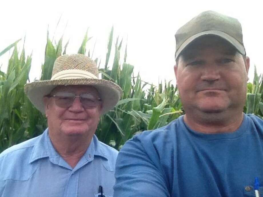 Though he is completing his 20th year as a farmer, Heath Rexrode and his father, Joe, continue a nearly 100-year tradition of farming on the South Plains. Heath (right) works with his father Joe (left). Photo: Courtesy Photo
