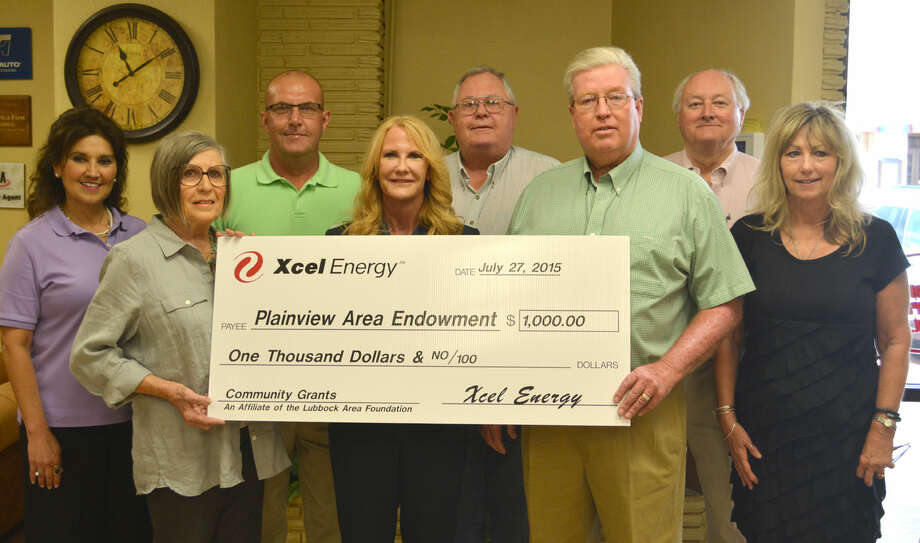 Doug McDonough/Plainview Herald The Xcel Energy Foundation on Friday presented the Plainview Area Endowment a gift of $1,000, which will be used to grow its endowment fund. On hand for the ceremonial check presentation are Frances Barrera (left), Plainview Area Endowment; Corky Terrell, Plainview Area Endowment; Chris LeFevre, Xcel Energy community service manager; Sheryl Cates, president of the Lubbock Area Foundation; Mark Warren, Plainview Area Endowment; Steven Deaton, Xcel Energy regional community manager; John Tye, Plainview Area Endowment; and Sue Castles, Xcel Energy community service manager.