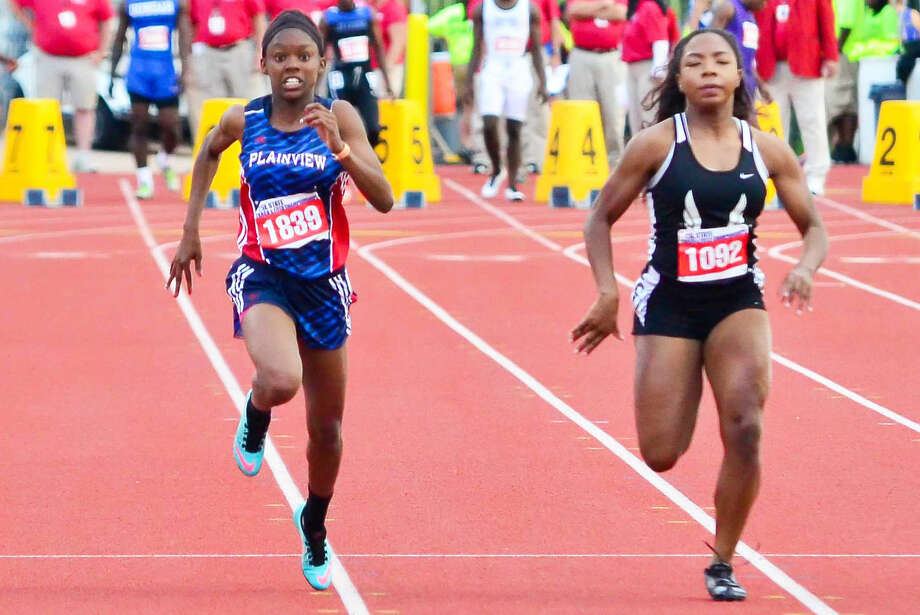 Plainview's Kaizha Roberts, left, competes in the 100-meter dash at the UIL state track meet in May. Roberts spent nine days in Australia last month as part of the Down Under Sports program. She got the chance to learn about the Australian culture and compete in a track meet. She ran on a 4x100-meter relay team that won a gold medal in the meet. Roberts also earned bronze medals in the 100-meter dash and long jump. She finished fourth in the triple jump. There were 26 competitors in each of the jumping events. After her time in Australia, Roberts traveled to Hawaii for a three-day vacation where she spent time on the beach and attended a Luau. Photo: Photo Courtesy Of Albert Gomez Photography