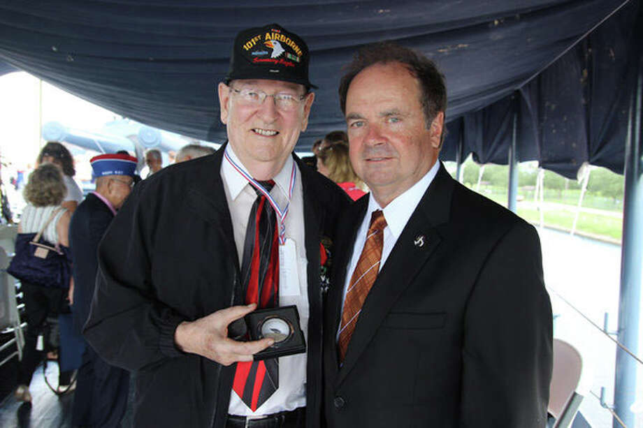 Photo courtesy City of La PorteWorld War II veteran Jimmy Holmes (left) is congratulated by La Porte Mayor Louis Rigby after Holmes and 35 other Texas WWII veterans were presented the French Legion of Honor, that country's highest military decoration, during ceremonies aboard the Battleship Texas on June 6.