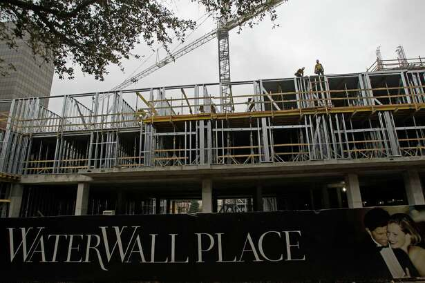 WaterWall Place, a high-end apartment complex, shown under construction Thursday, Feb. 7, 2013, in Houston. The seven-story property will overlook Gerald D. Hines Waterwall Park. ( Melissa Phillip / Houston Chronicle )