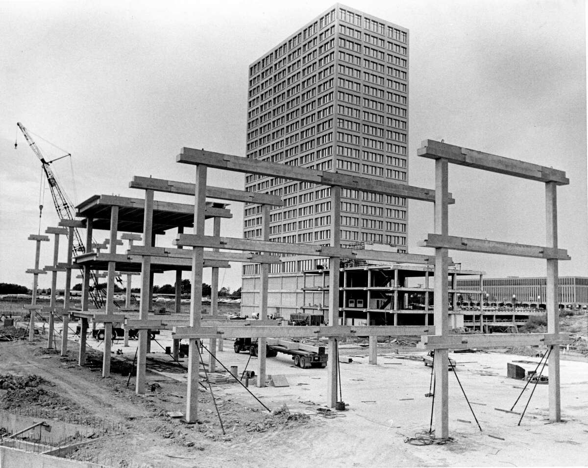 08/1969 - Construction has begun on framing for the three-level Galleria shopping complex in Galleria-Post Oak, an office building-hotel-commercial project being developed by Gerald D. Hines Interests near the intersection of Westheimer and Post Oak Blvd. near 610 West Loop. Post Oak Tower, an office building at one corner of the development, is seen behind the construction.