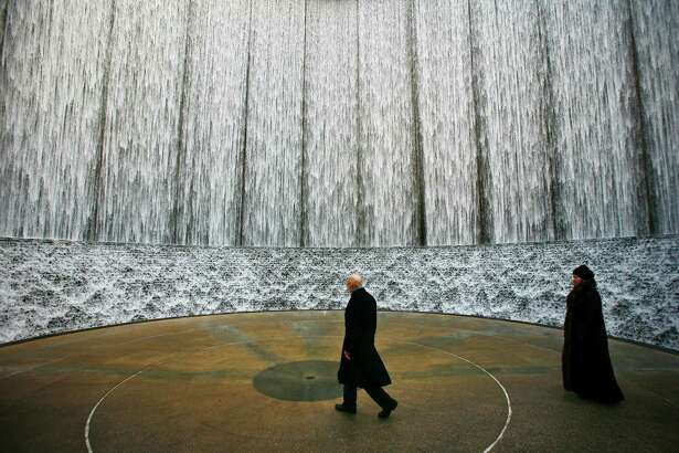 Gerald Hines and wife, Barbara, visit the Hines Waterwall after the dedication of the surrounding park in 2009.