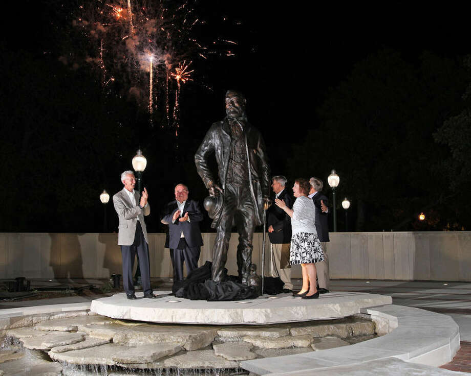 A 10-foot tall bronze sculpture of John Tarleton, the university's legendary founder, was unveiled Monday evening during a ceremony in the new Alumni Island on the Stephenville campus. Unveiling the bronze sculpture were (l-r) Tarleton President F. Dominic Dottavio, Tarleton Alumni Association President Mike Kornegay, artist Kenneth Wyatt, Alpha Building Corporation CEO Kathy Acock and longtime Alpha Building Corporation employee Richard H. Booher. Photo: Photo Courtesy Of Tarleton State