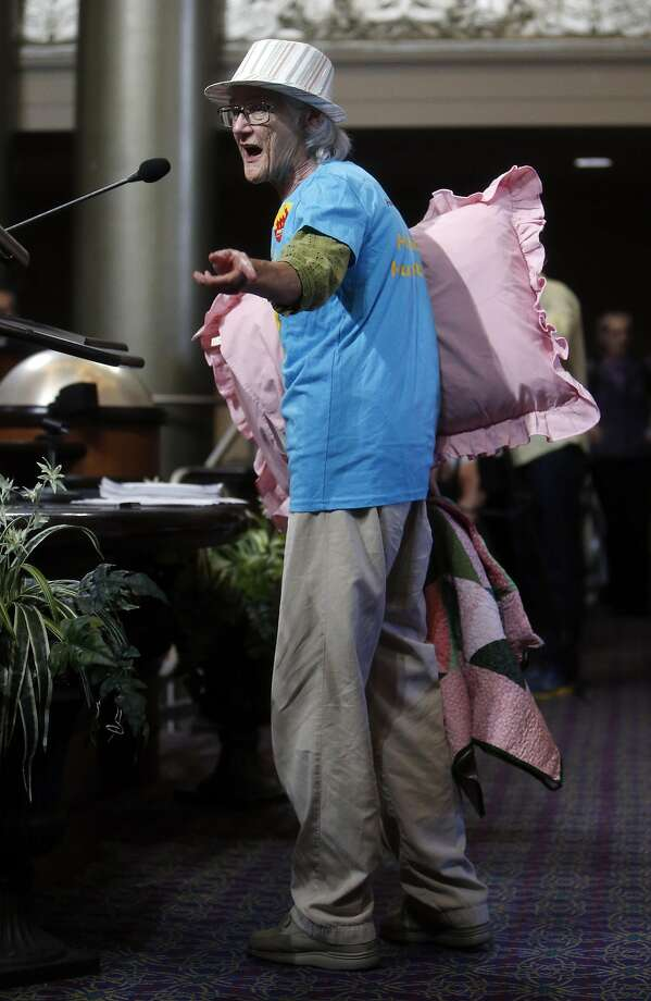 Expecting a long debate on rent control proposals, Karen Smulevitz brought a blanket and pillow to Oakland City Council meeting at City Hall in Oakland, Calif., on Tuesday, July 19, 2016. Photo: Scott Strazzante, The Chronicle