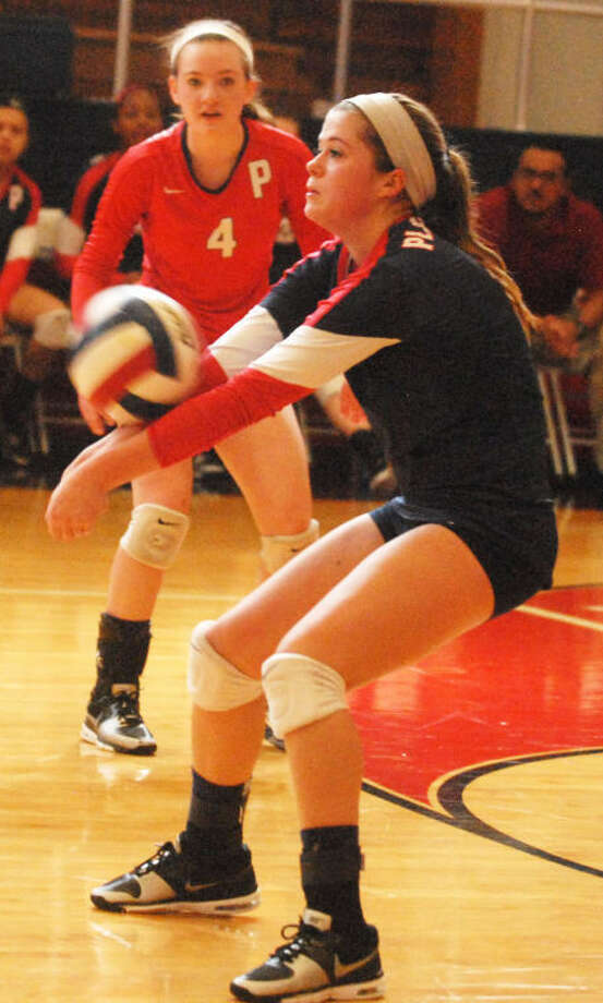 Plainview's Brooke Walker bumps the ball into the air as teammate Meredith McDonough looks on in the background during a match last year. They are two of eight returnees for the Lady Bulldogs, who hope to contend for a district championship this year. Photo: Skip Leon/Plainview Herald
