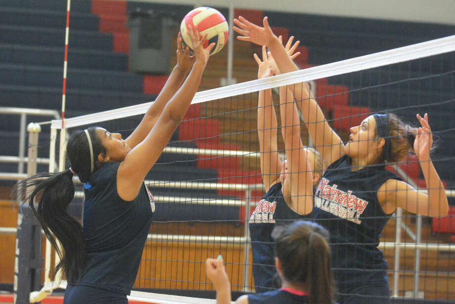 Plainview's Analisa Villa (left) battles teammate Harlee Davis (right) above the net during a volleyball practice. Both players are juniors and will be key contributors at middle blocker this season. The Lady Bulldogs open their regular season Monday with a pair of matches at the PHS gym. Photo: Skip Leon/Plainview Herald