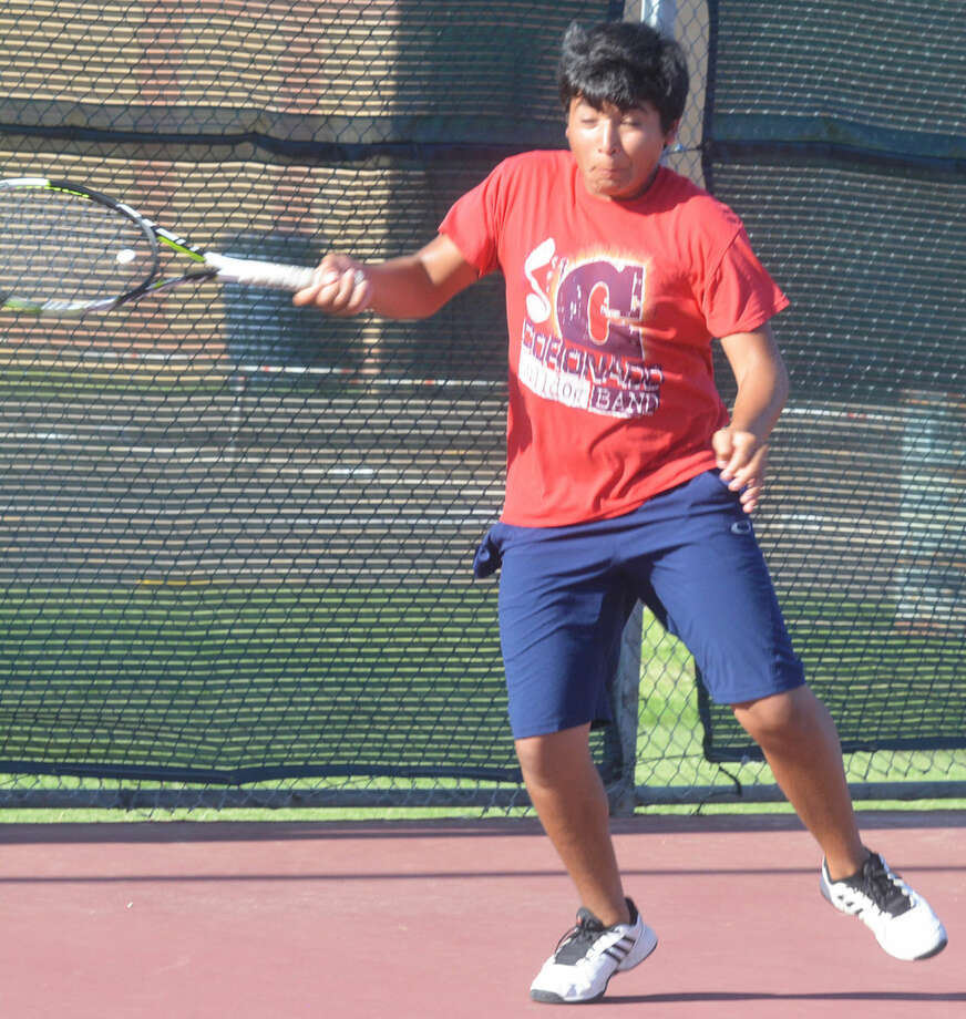 Plainview tennis player Patrick Cisneros returns a shot during a practice earlier this week. Cisneros is one of numerous returnees to a Bulldog tennis team that made the playoffs last season. Photo: Skip Leon/Plainview Herald