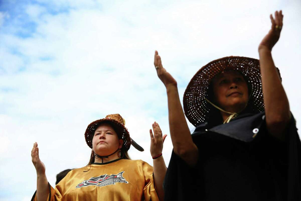Monica Teeals, left, and another member of the Nisqually tribe do a ceremonial dance during a dedication ceremony for the newly named Billy Frank Jr. Nisqually National Wildlife Refuge and Medicine Creek Treaty National Memorial, July 19, 2016.