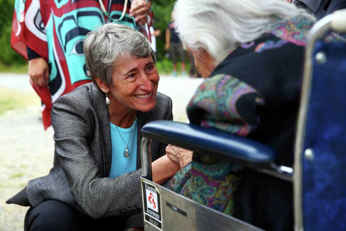 Secretary of the U.S. Department of Interior Sally Jewell greets Billy Frank Jr.'s older sister Maselle Bridges, 92, at a dedication ceremony for the newly named Billy Frank Jr. Nisqually National Wildlife Refuge, July 19, 2016.